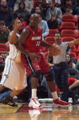 Shaquille O'Neal of the Miami Heat moves the ball in the low post against Tony Battie of the Orlando Magic during the game on December 19 2004 at...