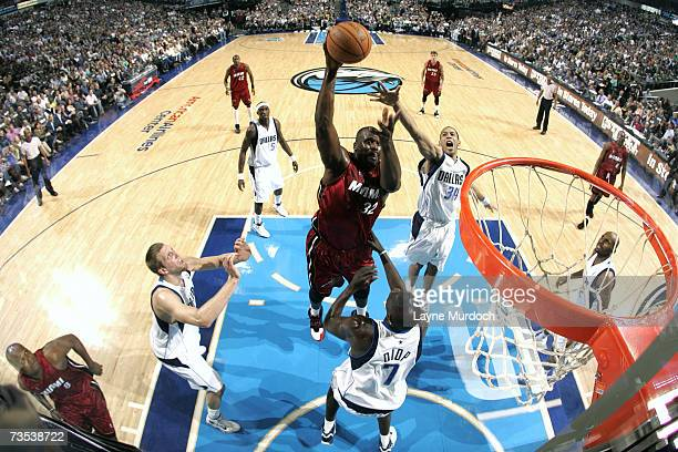 Shaquille O'Neal of the Miami Heat shoots against Devin Harris and DeSagana Diop of the Dallas Mavericks during the game at the American Airlines...