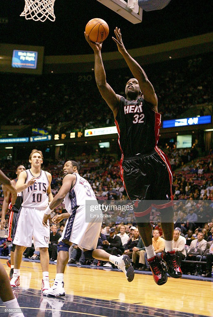 ... Shaquille ONeal 32 of the Miami Heat shoots as Alonzo Mourning 33 ... f420507a9
