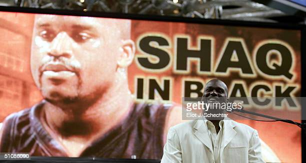Shaquille O'Neal of the Miami Heat smiles during a press conference to offically announce his arrival to the Miami Heat July 20 2004 at the American...