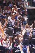 Shaquille O'Neal of the Orlando Magic blocks a jump shot by Patrick Ewing of the New York Knicks at Madison Square Garden during the 1992 season in...