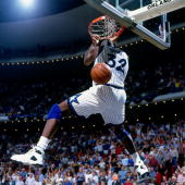 Shaquille O'Neal of the Orlando Magic dunks against the Indiana Pacers in Game One of the Eastern Conference Quarterfinals during the 1994 NBA...