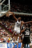 Shaquille O'Neal of the Orlando Magic dunks against the San Antonio Spurs during a 1993 NBA game at the Orlando Arena in Orlando Florida NOTE TO USER...