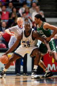 Shaquille O'Neal of the Orlando Magic posts up against Pervis Elson of the Boston Celtics in a game played on January 24 1995 at TD Waterhouse Centre...