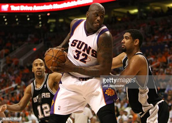 Shaquille O'Neal of the Phoenix Suns drives against Tim Duncan of the San Antonio Spurs during Game Three of the Western Conference Quarterfinals...