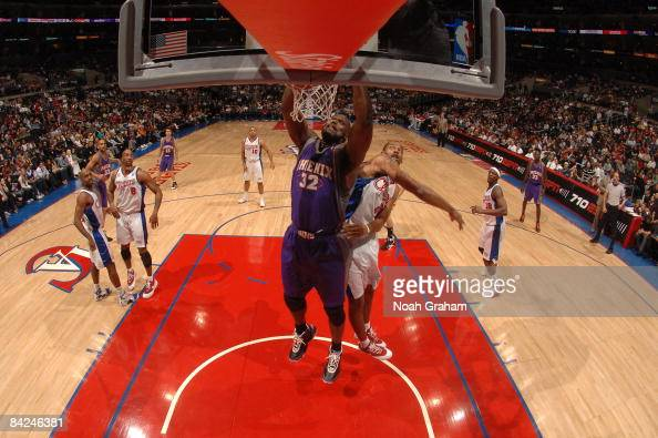 Shaquille O'Neal of the Phoenix Suns dunks against Marcus Camby of the Los Angeles Clippers at Staples Center on January 11 2009 in Los Angeles...