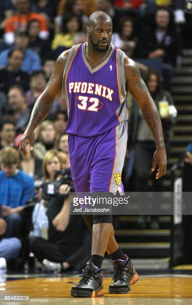 Shaquille O'Neal of the Phoenix Suns looks on against the Golden State Warriors during an NBA game on March 15 2009 at Oracle Arena in Oakland...