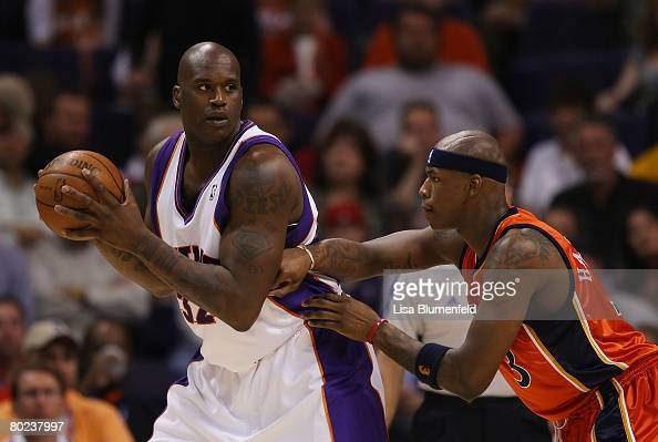 Shaquille O'Neal of the Phoenix Suns looks to pass against Al Harrington of the Golden State Warriors at US Airways Center on March 13 2008 in...