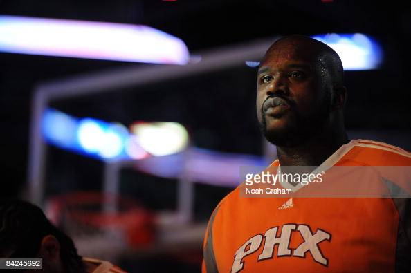 Shaquille O'Neal of the Phoenix Suns stands during the singing of the National Anthem before a game against the Los Angeles Clippers at Staples...