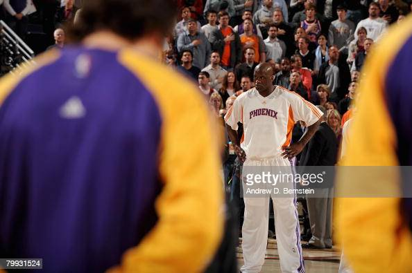 Shaquille O'Neal of the Phoenix Suns stands on the court during the national anthem before the game against the Los Angeles Lakers on February 20...