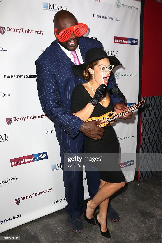 Shaquille O'Neal poses with Laticia Rolle at Barry University's 75th Anniversary Birthday Bash at Soho Studios on October 3, 2015 in Miami, Florida.