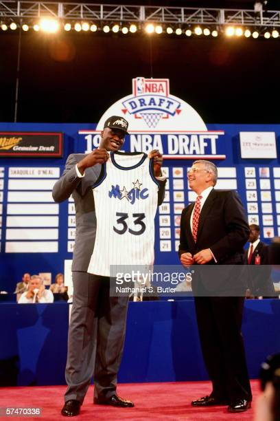Shaquille O'Neal poses with the Orlando Magic uniform with NBA Commissioner David Stern after being selected number one overall by the Orlando Magic...