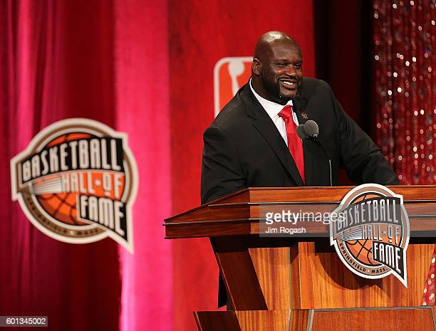 Shaquille O'Neal reacts during the 2016 Basketball Hall of Fame Enshrinement Ceremony at Symphony Hall on September 9 2016 in Springfield...