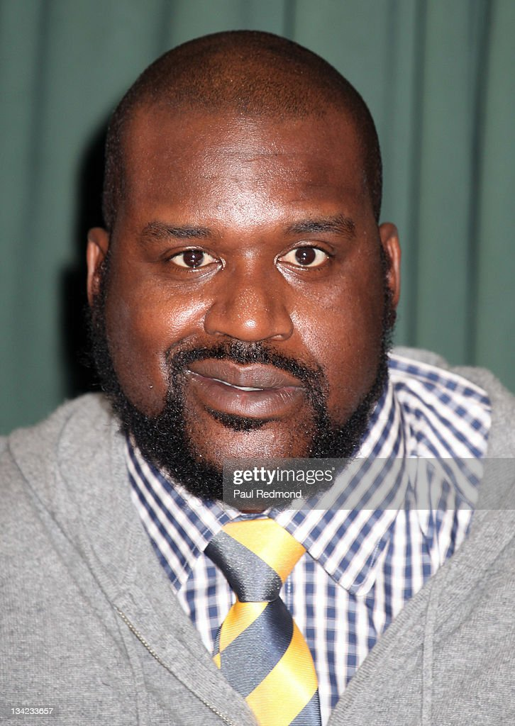 <a gi-track='captionPersonalityLinkClicked' href=/galleries/search?phrase=Shaquille+O%27Neal&family=editorial&specificpeople=201463 ng-click='$event.stopPropagation()'>Shaquille O'Neal</a> signs copies of his new book 'Shaq Uncut: My Story' at Vroman's Bookstore on November 28, 2011 in Pasadena, California.