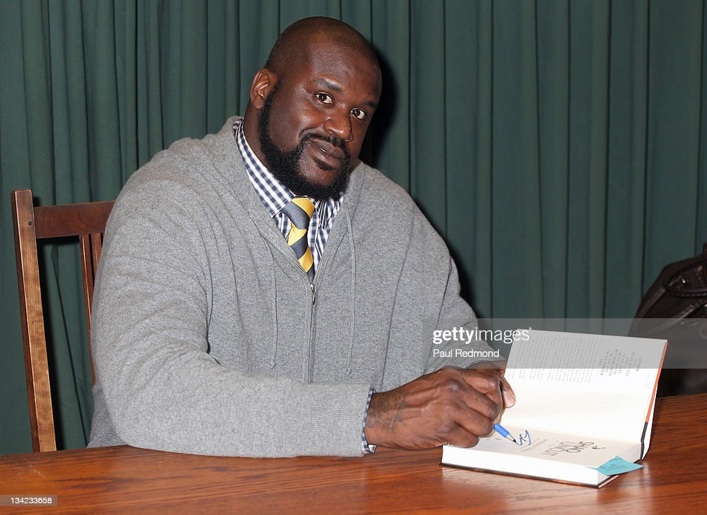 Shaquille O'Neal signs copies of his new book 'Shaq Uncut: My Story' at Vroman's Bookstore on November 28, 2011 in Pasadena, California.