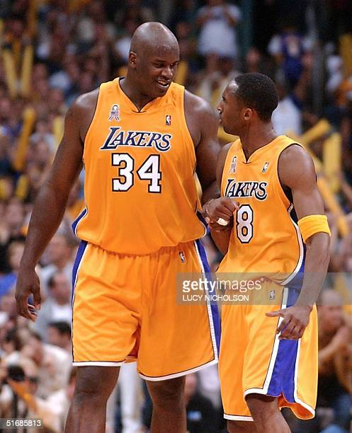 Shaquille O'Neal smiles at teammate Kobe Bryant of the Los Angeles Lakers during the 2nd half of Game 6 of the Western Conference Finals against the...