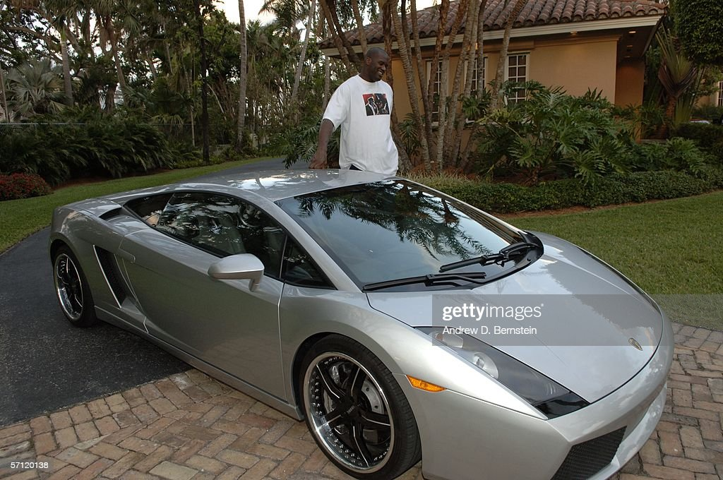 Shaquille O'Neal stands next to his Lamborghini at his home on March 6, 2006 in Star Island, Florida.