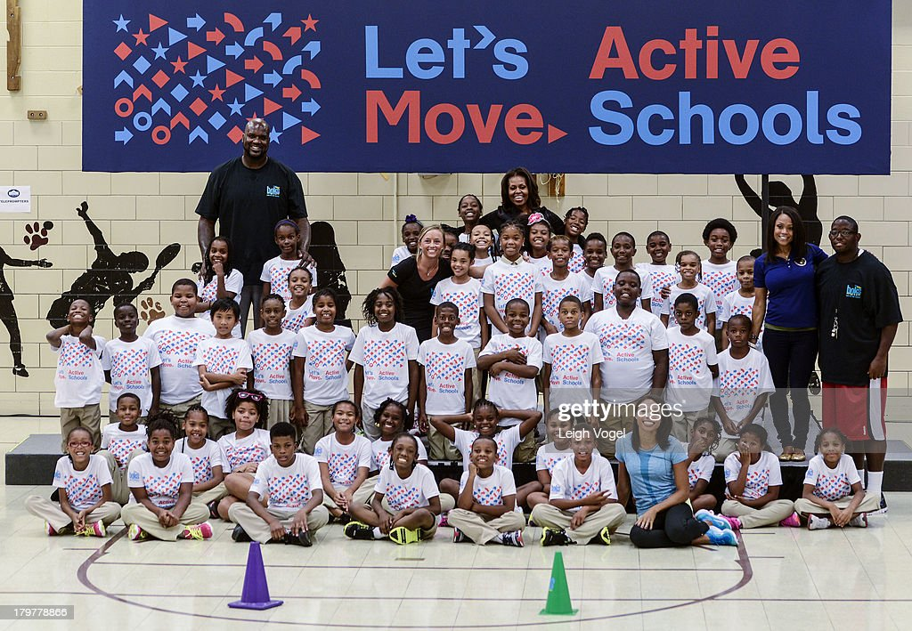 Shaquille O'Neal US First Lady Michelle Obama Allyson Felix and Dominique Dawes visit Orr Elementary in Washington DC for a back to school event...