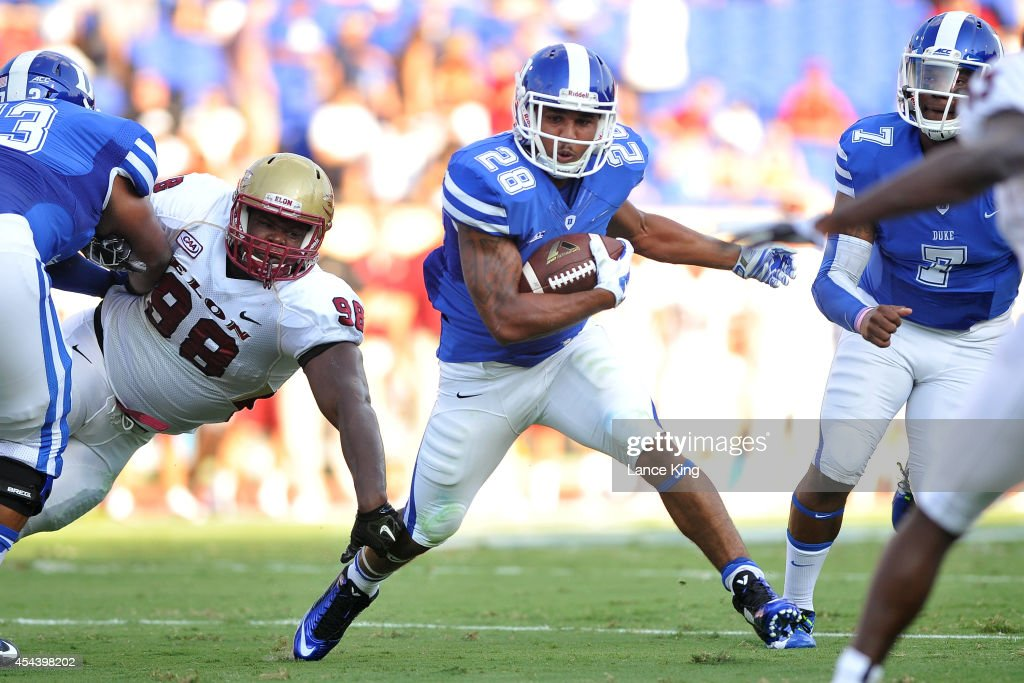 Shaquille Powell #28 of the Duke Blue Devils runs with the ball against the Elon Phoenix at Wallace Wade Stadium on August 30, 2014 in Durham, North Carolina.