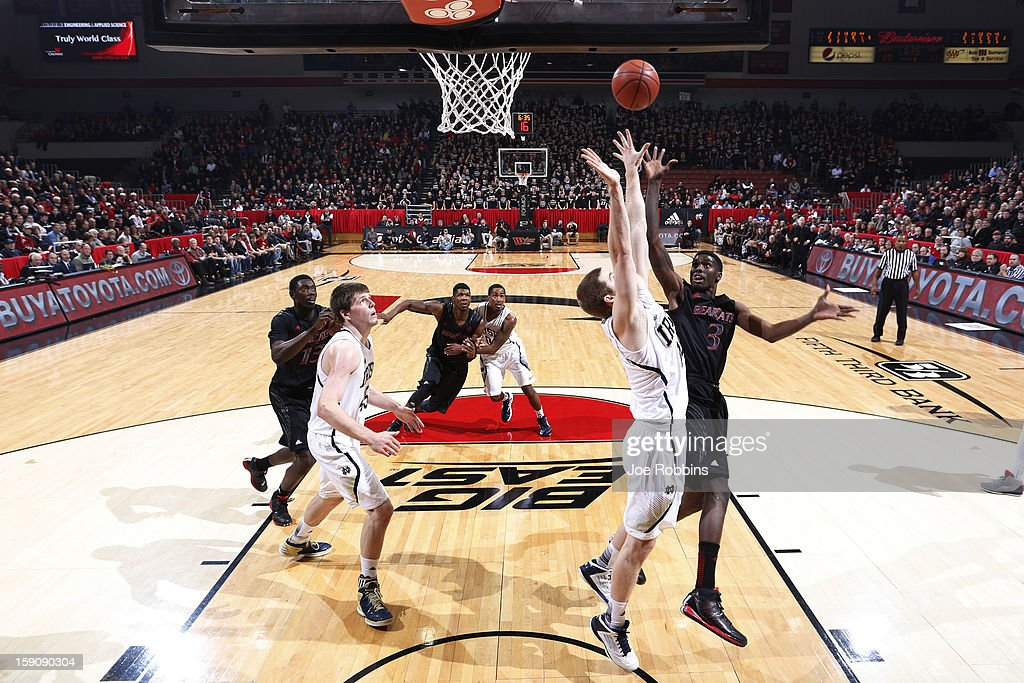 Shaquille Thomas #3 of the Cincinnati Bearcats goes up for a shot against <a gi-track='captionPersonalityLinkClicked' href=/galleries/search?phrase=Scott+Martin+-+Basketball+Player&family=editorial&specificpeople=15168896 ng-click='$event.stopPropagation()'>Scott Martin</a> #14 of the Notre Dame Fighting Irish during the game at Fifth Third Arena on January 7, 2013 in Cincinnati, Ohio. Notre Dame won 66-60.