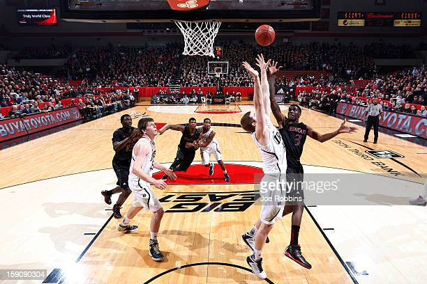 Shaquille Thomas of the Cincinnati Bearcats goes up for a shot against Scott Martin of the Notre Dame Fighting Irish during the game at Fifth Third...