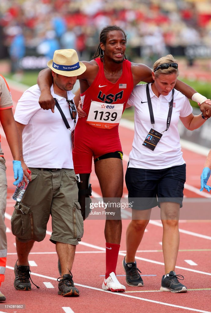 Shaquille Vance of USA is helped off the track after falling in the Men's 200m T42 during day four of the IPC Athletics World Championships on July 23, 2013 in Lyon, France.