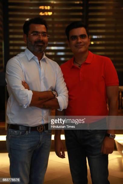 Sharad and Vikrant Batra during special dinner for Royal Challengers Bangalore teammates by Virat Kohli at his new restaurant Nueva RK Puram on May...