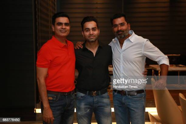 Sharad Batra Vikas Kohli and Vikrant Batra during special dinner for Royal Challengers Bangalore teammates by Virat Kohli at his new restaurant Nueva...