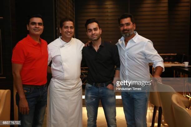 Sharad Batra Vikas Kohli Vikrant Batra and Chef Michael Swamy during special dinner for Royal Challengers Bangalore teammates by Virat Kohli at his...