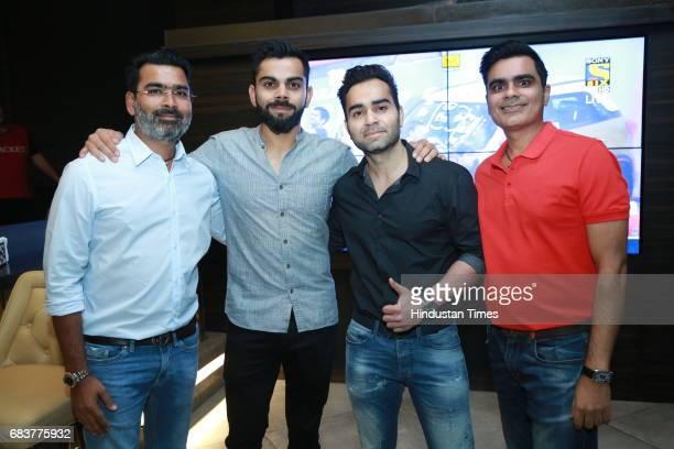 Sharad Batra Virat Kohli Vikas Kohli and Vikrant Batra during special dinner for Royal Challengers Bangalore teammates by Virat Kohli at his new...