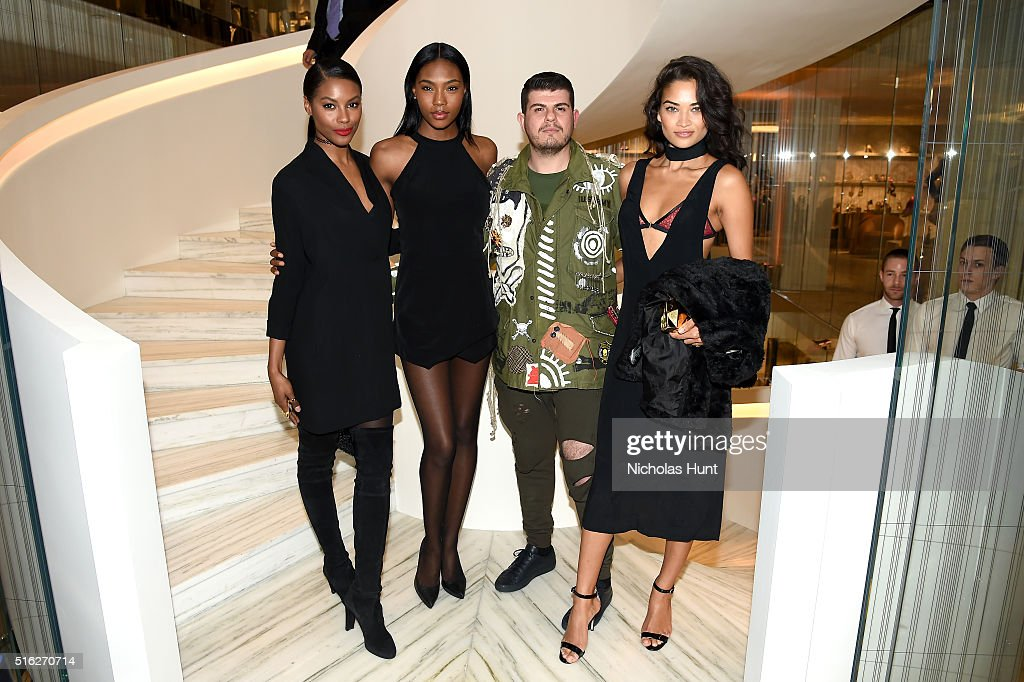 Sharam Diniz, Eli Mizrahi, and Shanina Shaik attend as Barneys New York celebrates its new downtown flagship in New York City on March 17, 2016 in New York City.