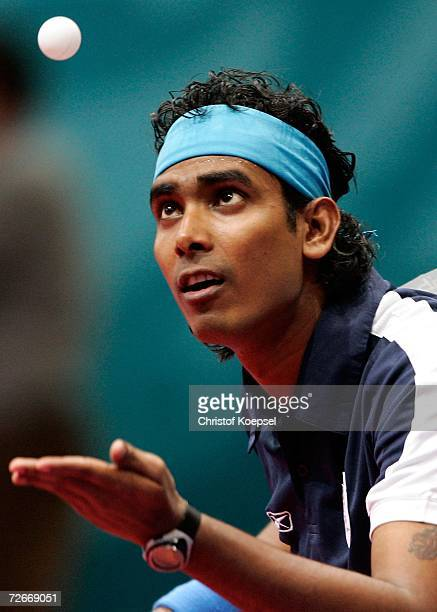 Sharath Kamal Achanta of India looks to serve during the Men's Team Round One at the 15th Asian Games Doha 2006 at AlArabi Indoor Hall November 29...