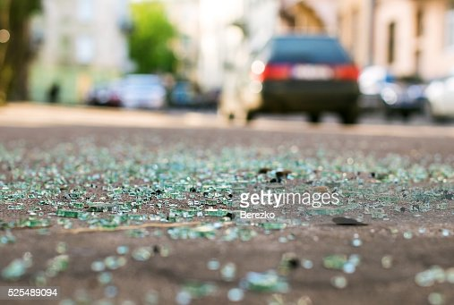 Shards of car glass on the street : Stock Photo