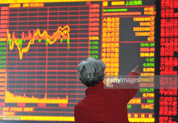 Share holders stay at a security trading floor on February 25 2015 in Shenyang Liaoning province of China Declining stock market appeared at the...