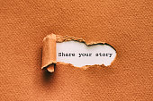 Share your story written under torn paper.