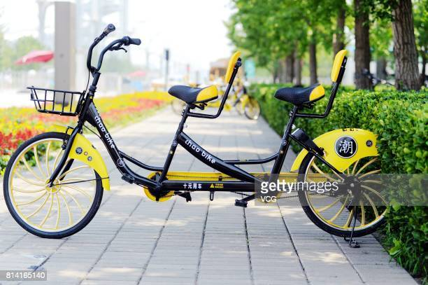 Shared tandem bikes are available at Beijing Olympic Park on July 12 2017 in Beijing China The shared bikes made for two cost RMB ten yuan per ride