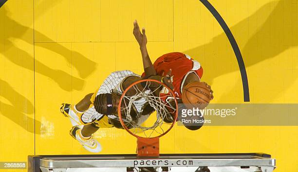 Shareef AbdurRahim of the Atlanta Hawks battles Jermaine O'Neal of the Indiana Pacers January 14 2004 at Conseco Fieldhouse in Indianapolis Indiana...