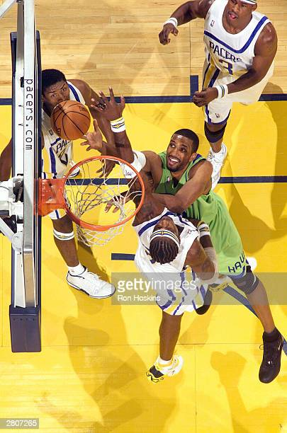 Shareef AbdurRahim of the Atlanta Hawks shoots over Jermaine O'Neal of the Indiana Pacers during NBA action December 12 2003 at Conseco Fieldhouse in...