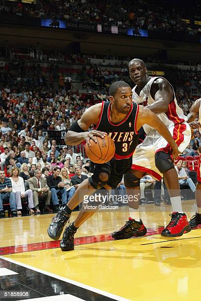 Shareef AbdurRahim of the Portland Trail Blazers drives around Shaquille O'Neal of the Miami Heat during the game at American Airlines Arena on...