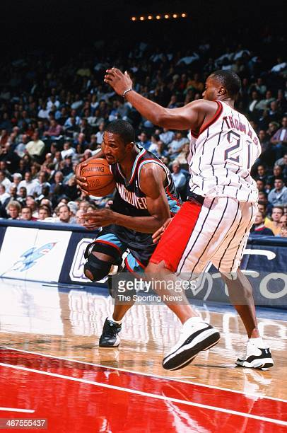 Shareef AbdurRahim of the Vancouver Grizzlies drives against Kenny Thomas of the Houston Rockets during the game on November 9 2000 at Compaq Center...