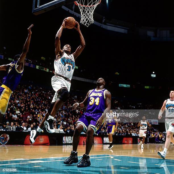 Shareef AbdurRahim of the Vancouver Grizzlies elevates for a dunk against Shaquille O'Neal of the Los Angeles Lakers during a game at General Motors...