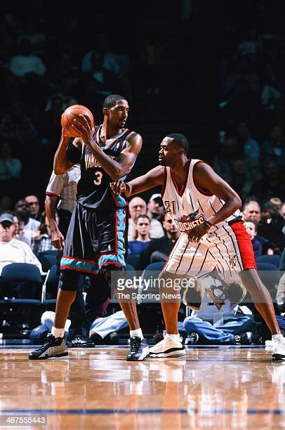 Shareef AbdurRahim of the Vancouver Grizzlies looks to move the ball against Kenny Thomas of the Houston Rockets during the game on November 9 2000...