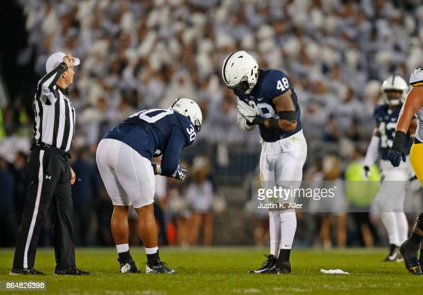 Shareef Miller and Kevin Givens of the Penn State Nittany Lions celebrate after a sack in the second half against the Michigan Wolverines on October...