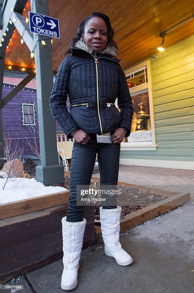 Shareeka Epps, actress in Sundance film Milkshake from Brooklyn, wearing faux cuir pants from American Apparel, Michael Kors down jacket, J-Crew scarf, and Tam snowboots on January 19, 2013 on the streets of Park City, Utah.