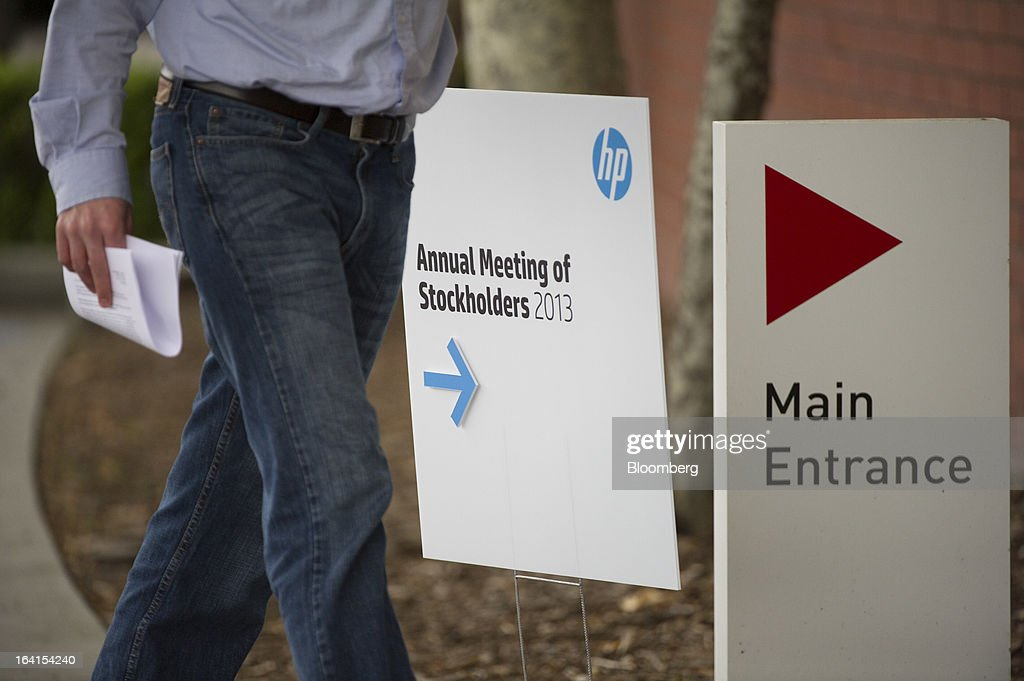 A shareholder arrives for the Hewlett-Packard Co. annual meeting in Mountain View, California, U.S., on Wednesday, March 20, 2013. Hewlett-Packard Co. investors will get the chance to voice dismay over the $8.8 billion writedown of Autonomy Corp. when they're asked to re-elect Chairman Ray Lane and other directors at an annual meeting today. Photographer: David Paul Morris/Bloomberg via Getty Images