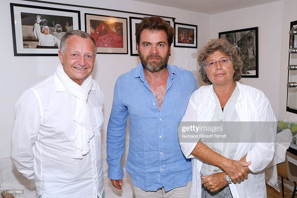 Shareholder of the Football Club Olympique Lyonnais and Actor <a gi-track='captionPersonalityLinkClicked' href=/galleries/search?phrase=Clovis+Cornillac&family=editorial&specificpeople=539501 ng-click='$event.stopPropagation()'>Clovis Cornillac</a> standing between President of the Football Club Olympique Lyonnais <a gi-track='captionPersonalityLinkClicked' href=/galleries/search?phrase=Jean-Michel+Aulas&family=editorial&specificpeople=596776 ng-click='$event.stopPropagation()'>Jean-Michel Aulas</a> and President of Ramatuelle Festival Jacqueline Franjou after 'La Contrebasse' play at 29th Ramatuelle Festival : Day 9 on August 8, 2013 in Ramatuelle, France.