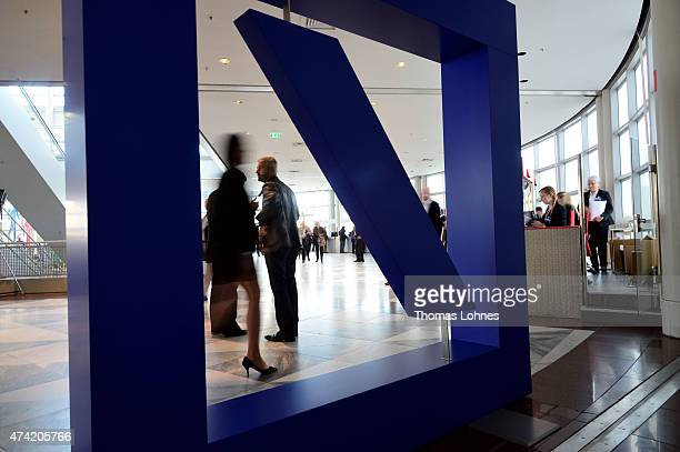 Shareholders arrive at Deutsche Bank's annual shareholder meeting on May 21 2015 in Frankfurt am Main Germany Deutsche Bank's shareholders are...