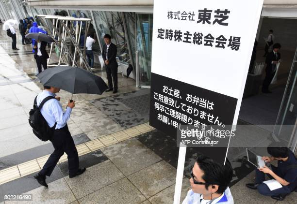 Shareholders arrive at Japan's Toshiba Corp for the annual meeting in Chiba Chiba prefecture on June 28 2017 Toshiba's shares were down 027 percent...
