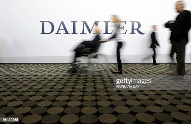 Shareholders arrive for the annual general meeting of German automaker Daimler on April 14 2010 in Berlin The company's CEO Dieter Zetsche said that...