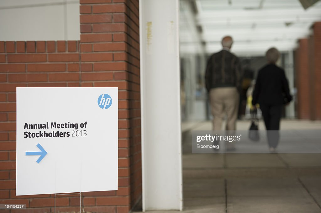 Shareholders arrive for the Hewlett-Packard Co. annual meeting in Mountain View, California, U.S., on Wednesday, March 20, 2013. Hewlett-Packard Co. investors will get the chance to voice dismay over the $8.8 billion writedown of Autonomy Corp. when they're asked to re-elect Chairman Ray Lane and other directors at an annual meeting today. Photographer: David Paul Morris/Bloomberg via Getty Images